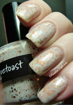 Crows Toes - springTHIS Collection | Pointless Cafe  MILQUETOAST - this is a white-based glitter polish with various sizes of metallic copper hex pieces and holographic copper micro-glitter. Two coats for opacity and one coat of Poshe top coat.