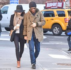 Coordinating: The couple matched in black hats for their winter walk