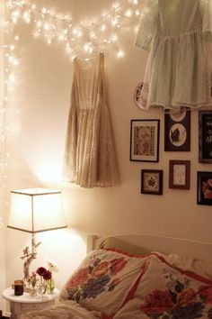 pillows and gallery wall/ a shelter from the storm/ why does this person hang their dresses on the wall????? lol???