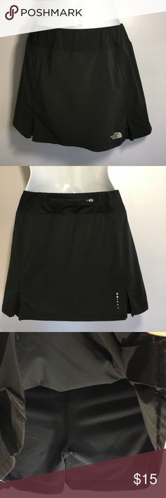 """The North Face Women's M black running Skort The North Face Skort   Womens size medium. Polyester spandex blend.  Nice lightweight material with very breathable lightweight shorts underneath the skirt. One zippered pocket in the back.  Elastic pull on waist style. In good condition with no stains tears or holes.  Measurements are 14.5"""" across flat front of waist (elastic so stretches more), 13.5"""" in total length from top to bottom The North Face Shorts Skorts"""