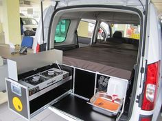 QuQuQ with stove, compartments and mattress, in a vehicle.. http://www.campingroadtrip.com/outdoor-living-newsletter-october-2013/ququq-rv-in-a-box
