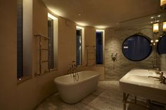Bathroom Lighting Design by John Cullen Lighting Contemporary Bathroom Lighting, Bathroom Lighting Design, Interior Lighting, Under Cupboard Lighting, Cupboard Lights, White Marble Bathrooms, Marble Showers, Loft Ensuite, Cosy Bathroom