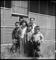 San Bruno, California. Young evacuees at this Assembly center beg to have their pictures taken., 06/16/1942