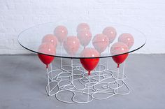 Duffy London's playful coffee table creates the illusion that it's held up by balloons #furniture_design