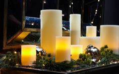 Fill your home with holiday cheer using fresh greenery, glowing flameless candles, and mercury glass ornaments.