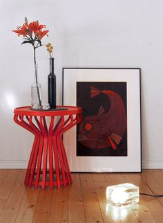red side table and fish art. cool.