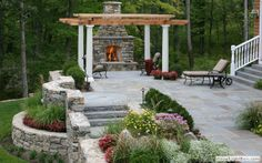 Fireplace and sitting area under pergola