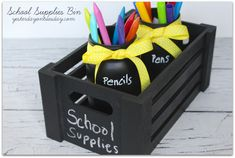 Keep school supplies organized with this DIY Chalkboard Book Bin with mason jars painted with chalkboard paint.