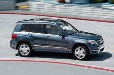 2013 Mercedes Benz GLK250 Bluetec 4Matic Side View In Motion Photo 17