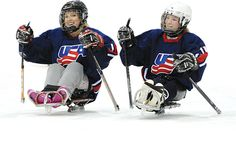 Erica Mitchell, left, brings veteran leadership to the new women's sled hockey program. Sledge Hockey, Hershey Bears, Adaptive Sports, Winter Olympics, Chicago Blackhawks, Ice Hockey, Motorcycle Jacket, Leadership, Bucket