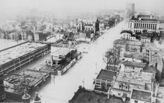 Broadway looking west from 4th Street, Louisville, Ky., 1937 flood. Greyhound Bus Station being built at 5th Street.