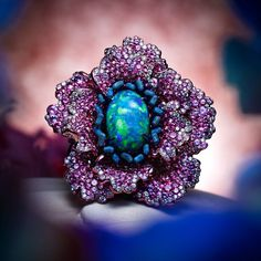 Chopard Fleurs d'Opales ring in white gold and titanium with a 9ct black opal surrounded by diamonds and sapphires