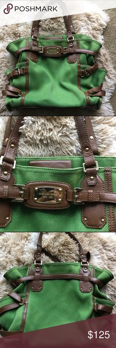 """Michael Kors Gansevoort bag Authentic Michael Kors Gansevoort bag used but has tons of life left! Green with brown leather and gold hardware  13""""h x 14""""w x 6""""d *no trades* Michael Kors Bags Satchels"""