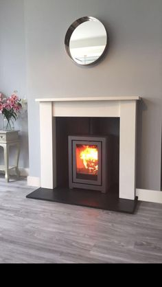HETAS registered installer of wood burning and multi-fuel stoves, fireplace surrounds in the Stockport, Heaton Moor, Heaton Norris, Heaton Chapel and Manchester area Fake Fireplace, Fireplace Surrounds, Fireplace Mantels, Fireplace Ideas, Living Room With Stove, Log Burner Living Room, Living Room Designs, Living Room Decor, Dining Room