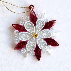 https://flic.kr/p/BxnN6e | 6 point small red and white quilled snowflake with gold glitter: