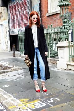 This could be done a lot of ways... overcoat/silky blouse, long cardigan/graphic tee, etc.