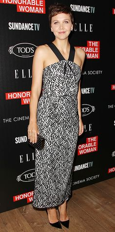 Maggie Gyllenhaal made a chic appearance at The Honourable Woman screening in a stunning lace Roland Mouret design, styling her look with studs, a minaudiere, and black pumps.