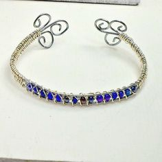 Wirewrap bracelet iridescent blue beads narrow cuff size 7 Handmade by Pat2 Free Shipping by RememberThis3 on Etsy