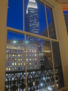 The Empire State Building tower, in its new LED brilliance, looms outside the window at Stella 34 - NYC