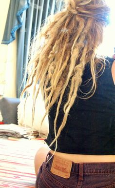 My 1 year old dreads look like they'll be more like this when they mature, but with more medallions! Hippie Dreads, Dreadlocks Girl, Hippie Hair, Hippie Boho, Medieval Hairstyles, Dreadlock Hairstyles, Half Dreaded Hair, Half Dreads, Colored Dreads