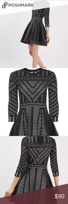 Topshop Geometric Print Dress Fit and flare silhouette. Lovely heavy knit material. Looks great paired with tights and booties. This dress is really hard to find! Fabric has a lot of stretch. Topshop Dresses