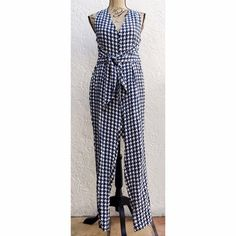 "VASSALLO Navy & White Belted Houndstooth Jumpsuit From the Spring 2015 Collection. Vassallo ""Mini"" Houndstooth Jumpsuit.  Classic, Retro Style in Navy & White. V Neck Front with Criss-Cross Back Straps. Adjustable Waist Belt Tie which you can style anyway you want. Straight leg cropped pant. Size 4. Brand New with Tags. Vassallo Pants Jumpsuits & Rompers"