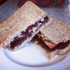Protein Chocolate PB Sandwich  mix 1/2 scoop chocolate whey, 1 tbsp unsweetened dark cocoa powder, a lil unsweetened almond milk & 1 tbsp dark chocolate dreams peanut butter Spread on 2 slices of Ezekiel bread and put sliced strawberries between.