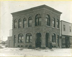 The Greene Block on the corner of Ross Street and Gaetz Avenue, 1904. The first Council chambers for the Town of Red Deer were on the second floor of this building. In the doorway are George Wellington Greene (builder of block) his partner W.E. Payne and to the right, Leonard Crane Fulmer, first secretary treasurer of the Town of Red Deer.