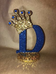 Graduation Party Decor Discover top to bottom Sparkle letters with crown. Royal themed decoration for party decorations baby showers princess and prince Royalty Baby Shower Theme, Boy Baby Shower Themes, Baby Boy Shower, Royalty Theme Party, Prince Birthday Party, Baby Boy 1st Birthday, 1st Birthday Parties, Crown Centerpiece, Party Centerpieces
