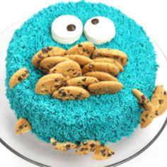 Cookie Monster Cake {Video Tutorial}   How to make a super-silly Cookie Monster Cake! This cake is hysterical and perfect to make for any occasion. It's layered with moist chocolate cake, whipped cream, crushed cookies, chocolate ganache and American butter cream icing!   http://angelfoods.net/cookie-monster-cake-video-tutorial