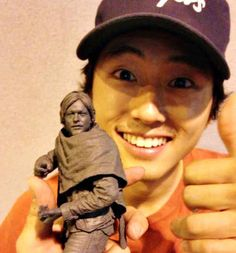 Steven Yuen and the way he poses with little statues of Norman Reedus.