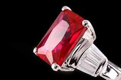 macro photo of a red ruby in a ring