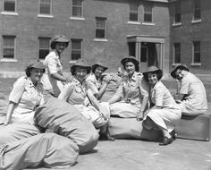 7 members of the USMCWR arrive from Camp Lejeune, New River, North Carolina, for their first aviation duty at the Marine Corps Air Station at Cherry Point, North Carolina. Tired but enthusiastic, they are shown seated on suitcases and seabags, customarily used in place of trunks in the Marine Corps. l to r:Private Evelyn Hawse; Private Barbara Z. Levy; Private Kathryn Connelly; Private Marguerite Golenor; Private Helen A. Kozel; Private Teresa Cantillon; Private Sally G. Glinski ~