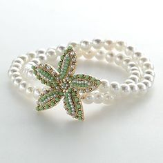 LC Lauren Conrad Pearl Starfish bracelet. Think I have t have this with the necklace ☺
