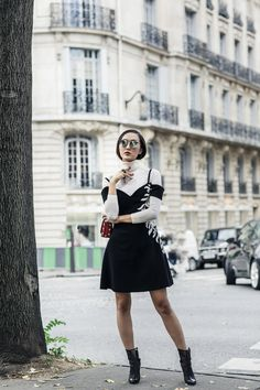 Chriselle Lim wearing a Cinq a Sept dress, Theory turtleneck, Reed Krakoff shoes, Vedi Vero sunnies.