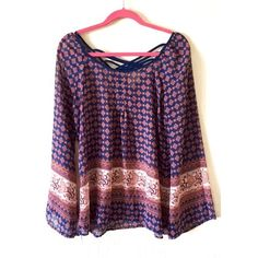 Light Flowy Print Blouse Great condition. Light, flowy fabric. Bell sleeves. Back has criss cross detail at the top. Fits Size Large but would be cute as an oversized look for someone who is normally medium or even small. Tops Blouses