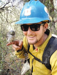 Prescott, AZ ~ Fire Fighter Blue Ridge Hot Shot member Ronnie Gamble, a Prescott resident, holds a baby owl firefighters found while fighting the Doce fire. The owl was no longer in danger, so they put it back in the tree where it was found so its mother could find it. Gamble said the owl was very friendly and didn't try to fly away at all.