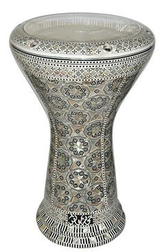 """GAWHARET EL FAN Mother of Pearl DOUMBEK DRUM 17.5"""" Drum by GAWHARET EL FAN. $329.00. This is a beautiful new 17.5"""" darbuka. It's the new generation of GEF drums. Higher and wider with a unique bottom finishing. Amazing Drum! Comes with a clear synthetic head and a premium case. This drum is a top quality drum! The Beautiful and intricate inlay of real mother of pearl and the beautiful patterns make this drum a real work of art. Covered with real mother of pearl ..."""