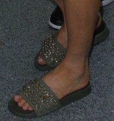 Fergie wearing Chanel khaki green gold chain slide sandals