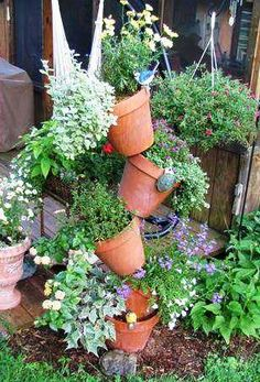 a Tipsy Flower Pot Tower I am SO doing this for an herb garden!I am SO doing this for an herb garden! Diy Herb Garden, Garden Art, Garden Design, Flower Pot Tower, Flower Pots, Diy Flower, Flowers, Backyard Projects, Garden Projects