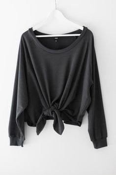 "Super comfy oversized pull-over sweatshirt with front knot detailing. Wide neckline and a slouchy fit. Made with french terry knit material. Size small measures approx. 21"" in length. - 35% Cotton 65%"