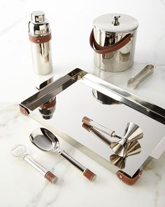 Ralph Lauren nickel-plated stainless steel Preston Barware with saddle leather accents.