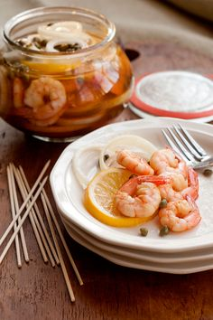 Pickled shrimp - Boiled shrimp layered with lemon slices, onion and capers and marinated in cider vinegar.