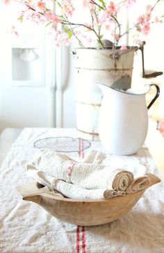 French farmhouse, flower bucket, white linens, red stripe, pink flowers, antique white pitcher