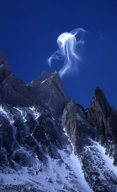 Is it the moon on the mountain?, No it's a Jellyfish cloud. Cerro Torre, Argentina.