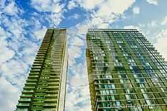 Tall twin buildings with blue sky
