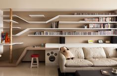 """Custom Shelving In This Home Keeps The Cat Happy - """" When Taiwanese design firm Thinking Design were tasked with designing a home for their client with a cat, they decided to include a 'catwalk' for the family feline."""""""