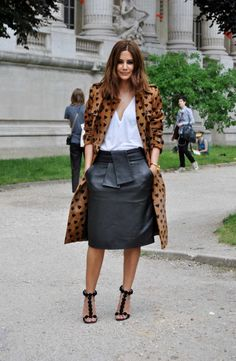 Christine Centenera in a tan Burberry heart print trench coat + white tee + black leather skirt + black ankle-strap heels