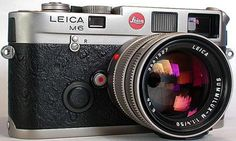 A Leica M6 with a 50mm lens ... and maybe a wide-angle as well.