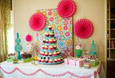Site with great party styling ideas.  Love this fabric covered canvas + the fans!